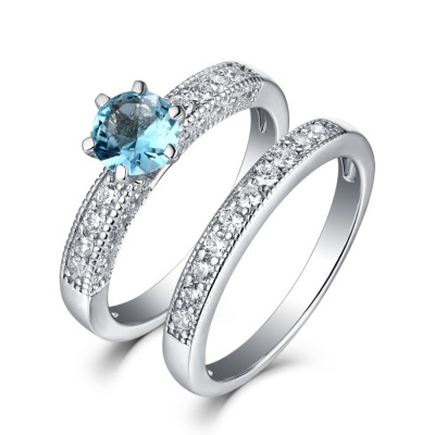 Tinnivi Sterling Silver Round Cut Created Sapphire 2 Piece Bridal Ring Set