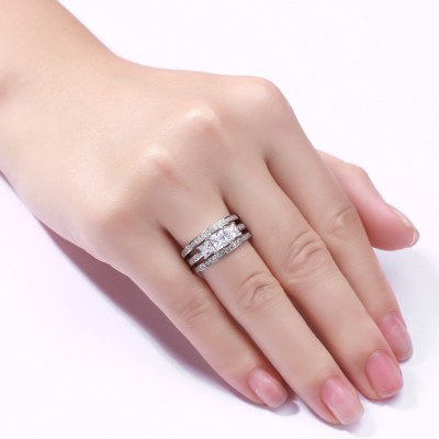 Tinnivi Sterling Silver Round Cut Created White Sapphire Three Stone 3PC Wedding Ring Set