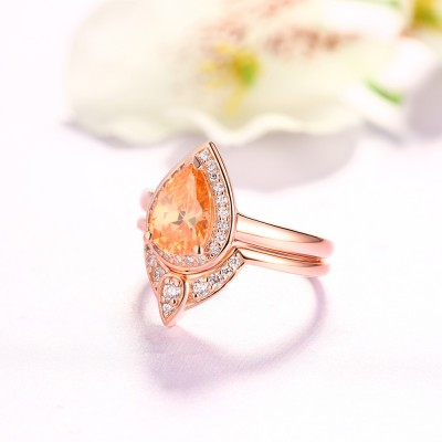 Tinnivi Pear Cut Created White Sapphire Engagement Ring with Matching Side Band Ring Set